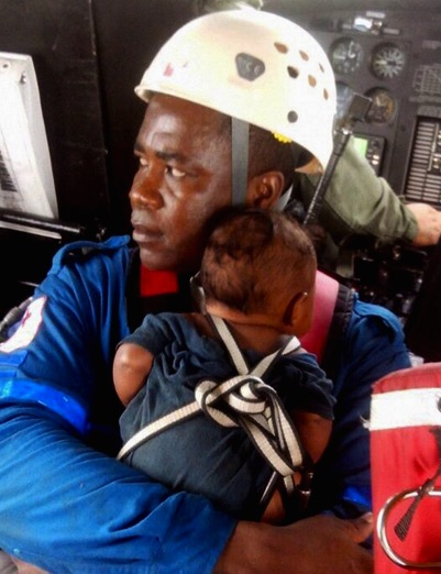 A member of the Red Cross carries Yudier Moreno. Photograph: Colombian Air Force/EPA
