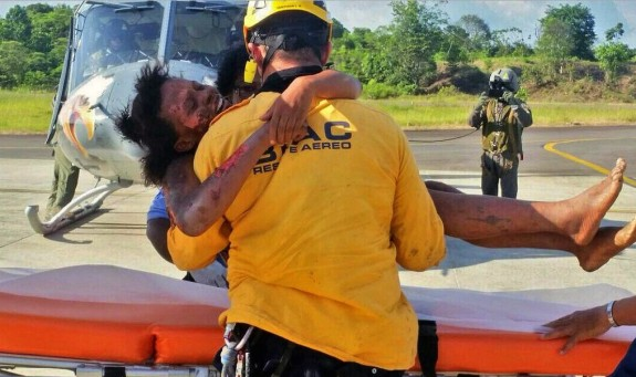 A rescue worker helping Murillo after her rescue. Photograph: Colombian Air Force/EPA
