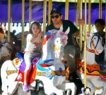 Paul Rudd and his daughter Darby enjoy a ride at King Arthur Carrousel
