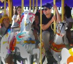Paul Rudd and his daughter Darby enjoy a ride at King Arthur Carrousel, Anaheim