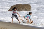Sunny and Sadie Sandler at the beach with their parents for Father's Day