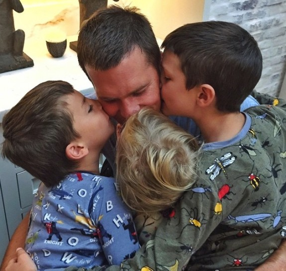 Tom Brady gets hugs from his kidsm John, Vivian and Ben