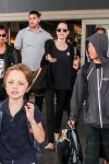 Angelina Jolie departs LAX with son Maddox, Pax and Knox