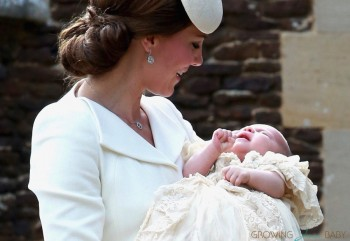Duchess of Cambridge carrier Princess Charlotte in her Christening Gown