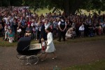 Duke & Duchess of Cambridge push baby Charlotte in a Millson pram on Christening Day