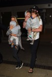 Elsa Pataky and Chris Hemsworth at LAX with their kids India, Tristan and Sasha