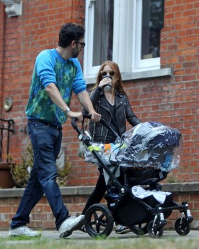 Isla Fisher and Sacha Baron Cohen take their 4-month-old baby Montgomery Moses Brian for a stroll