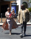 Kim Kardashian and Kanye West with daughter North leaving the movies