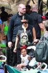 Kim Kardashian at DIsneyland for Penelope's birthday with North West