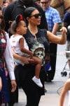 Kim Kardashian at DIsneyland with North West