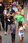 Kim and Kourtney Kardashian at Disneyland with their kids North, Mason and Penelope
