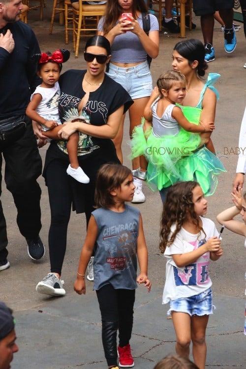 Kim and Kourtney Kardashian at Disneyland with their kids North, Mason and Penelope