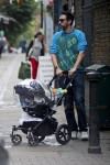 Sacha Baron Cohen takes his 4-month-old baby Montgomery Moses Brian for a stroll