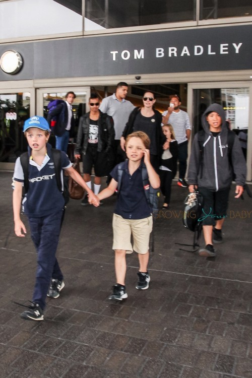 Shiloh Jolie-Pitt exits LAX with brother Knox