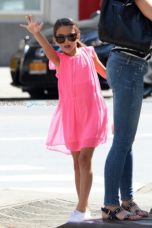 Suri Cruise hails a cab in NYC
