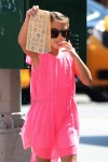 Suri Cruise snacks on donuts in NYC
