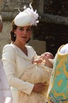 The Duchess of Cambridge, Kate Middleton cradles Princess Charlotte at her Christening