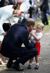 The Duke and Duchess of Cambridge with son Prince George at Princess Charlotte's Christening