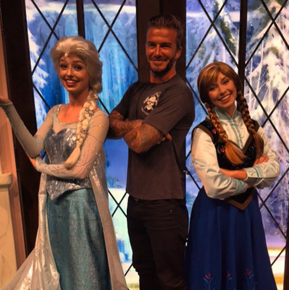 David Beckham poses with Frozen characters at Disneyland