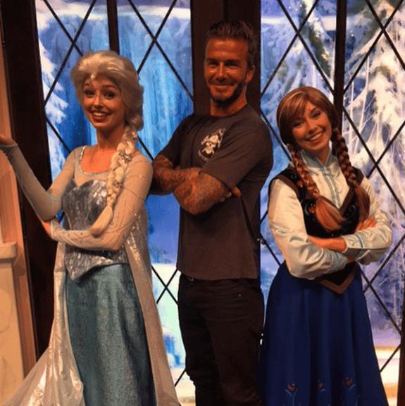 David Beckham poses with Frozen characters at Disneyland