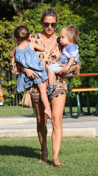 Elsa Pataky juggles her daughter India Hemsworth and twin son at the park