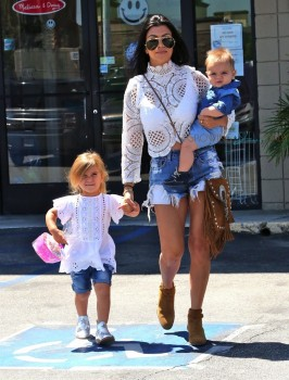Kourtney Kardashian out at a birthday party with daughter Penelope and son Reign Disick