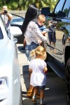 Kourtney Kardashian out at a birthday party with daughter Penelope & son Reign Disick