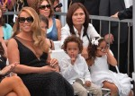 Mariah Carey sits with her twins Moroccan and Monroe Cannon at Hollywood Walk Of Fame Star Ceremony