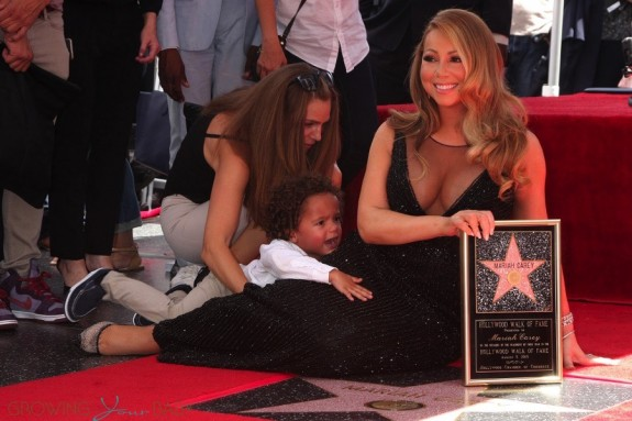 Moroccan Cannon holds on to his mom Mariah Carey at her Hollywood Walk of Fame Ceremony
