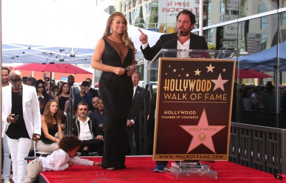 Moroccan Cannon reaches for his mom Mariah Carey at her Hollywood Walk of Fame Ceremony