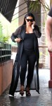 Pregnant Kim Kardashian and mother Kris Jenner match in black outfits as they enjoy lunch in Los Angeles