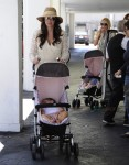 Tamara Ecclestone and sister Petra Stunt push their daughters in matching pink Fendi Monster strollers in Beverly Hills