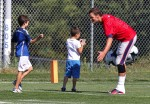 Tom Brady at Football practise with sons John and Ben