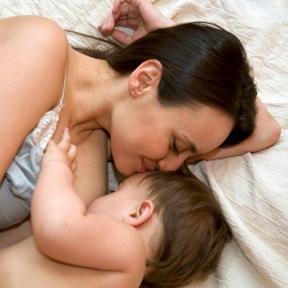 Mom breastfeeding side lying