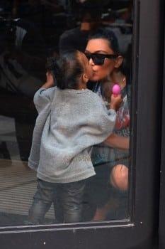 Pregnant Kim Kardashian kisses daughter North West at Toys R US
