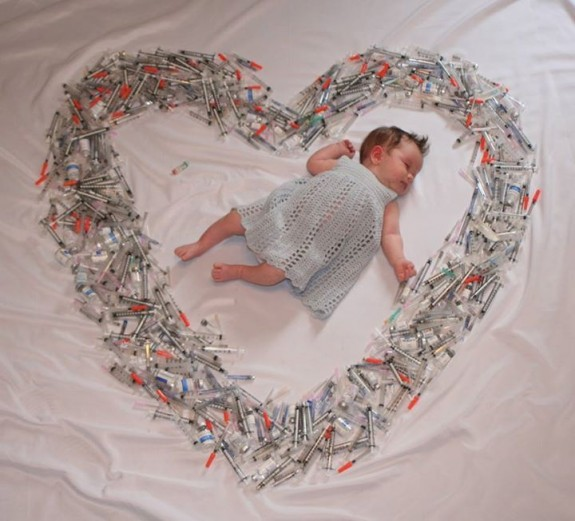Mom Shares Image of Baby surrounded by Syringes To Create Awareness About Infertility
