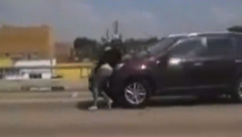 Motorists Film Video Of Pregnant Woman Clings to Car Driving on Freeway