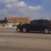 Motorists Film Video Of Pregnant Woman Clinging to Car Driving on Freeway
