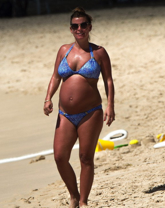 Pregnant Coleen Rooney spends time on the beach in Barbados