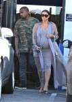 Pregnant Kim Kardashian leaves a studio in LA with husband Kanye West