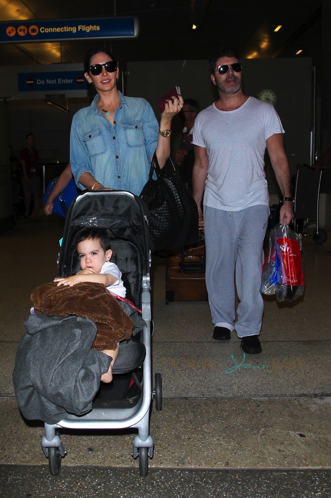 Simon Cowell and Lauren Silverman at LAX with son Eric ...