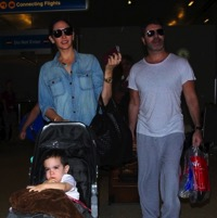 Simon Cowell & His Family Land At LAX