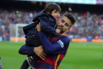 Gerard Pique with his son Milan at the La Liga match between FC Barcelona and Real Sociedad de Futbol