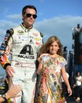 Jeff Gordon, driver of the #24 AXALTA Chevrolet, walks on the track with his daughter Ella Gordon prior to the start of the NASCAR Sprint Cup Series Ford EcoBoost 400 at Homestead-Miami Speedway