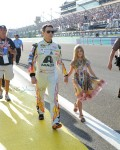 Jeff Gordon, driver of the #24 AXALTA Chevrolet, walks on the track with his daughter Ella prior to the start of the NASCAR Sprint Cup Series Ford EcoBoost 400 at Homestead-Miami Speedway