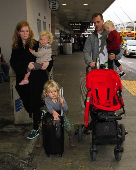 James Van Der Beek and wife Kimbery with kids Annabel, Olivia and Joshua at LAX