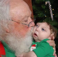 Baby Born With Severe Disability Beats Odds, Enjoys First Visit With Santa!