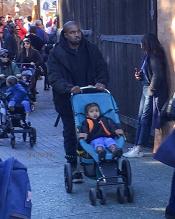 Kanye West at DIsneyland with daughter North