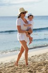 Lauren Silverman with son Eric Cowell on the beach in Barbados