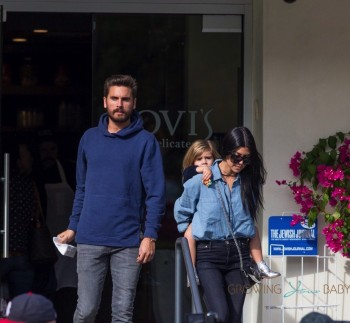 Penelope Disick gets a piggy back ride after a lunch at Lovi's with her mom Kourtney and dad Scott